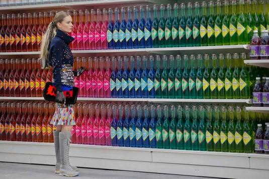 "A model presents a creation by German designer Karl Lagerfeld as part of his Fall/Winter 2014-2015 women's ready-to-wear collection for French fashion house Chanel at the Grand Palais transformed into a ""Chanel Shopping Center"" during Paris Fashion Week March 4, 2014. REUTERS/Stephane Mahe (FRANCE - Tags: FASHION)"